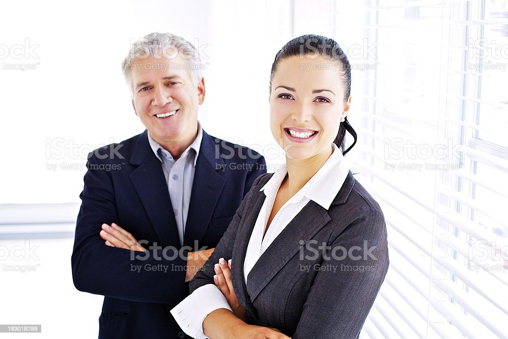 experienced men with young dynamic woman stock photo