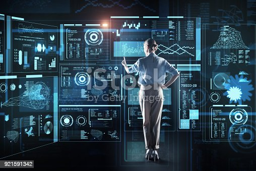 istock Experienced programmer pointing to the screen and looking elegant 921591342