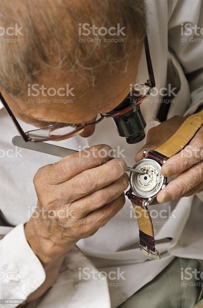 Experienced watch repair man stock photo