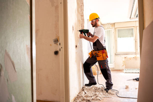 Experienced worker using hammer drill Experienced worker using hammer drill for tearing down a wall structure demolishing stock pictures, royalty-free photos & images