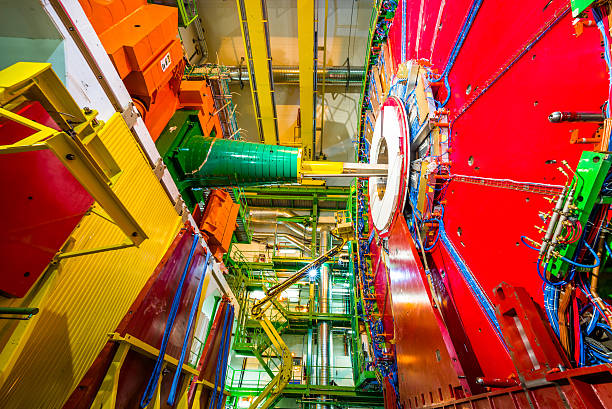 CMS Experiment Detector The 14,000 tonnes CMS detector, housed in a cathedral-like cavern, is an astounding feat of engineering and a symbol of large-scale international collaboration. large hadron collider stock pictures, royalty-free photos & images