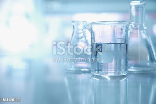 istock experiment water in beaker and flask in chemistry science laboratory background 891126112