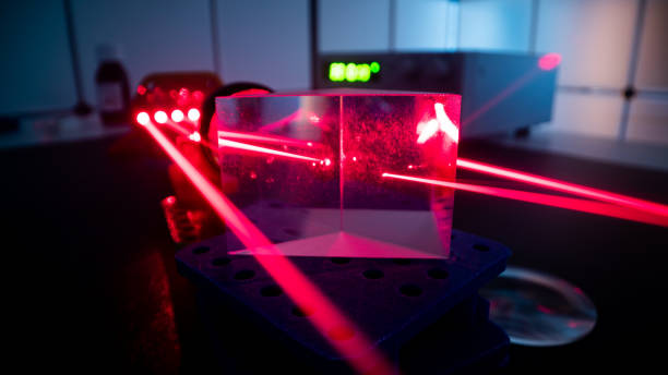 Experiment with red laser in optics lab stock photo