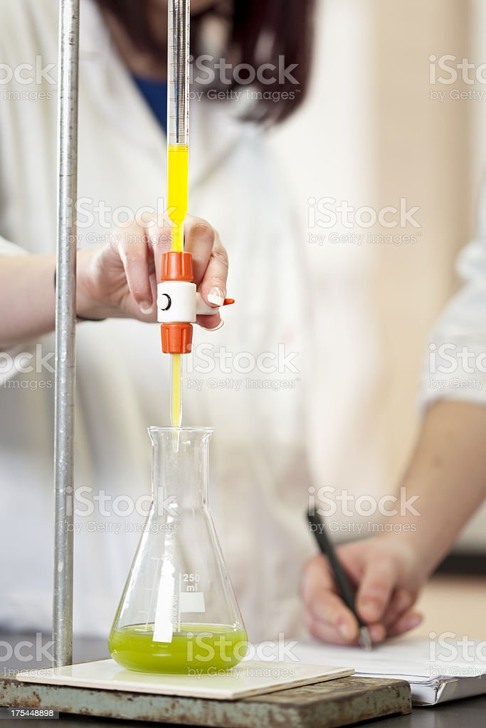 Experimenting with liquids in the science lab chemistry royalty-free stock photo