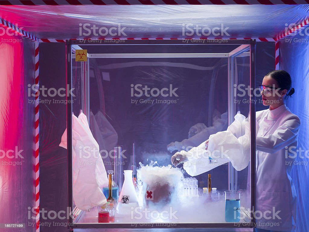 experimenting with steaming substance in protective enclosure royalty-free stock photo