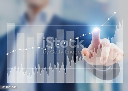 istock Expert businessman using business intelligence to sketch success on charts 519831592