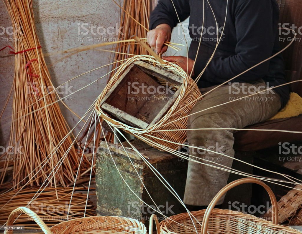 Expert craftsman while creating a basket stock photo