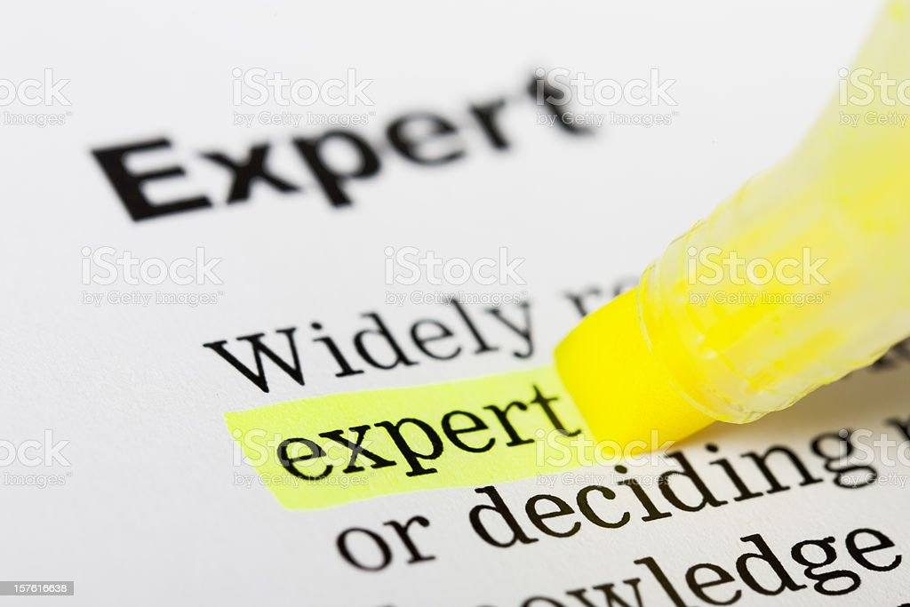 Expert highlighted in yellow royalty-free stock photo
