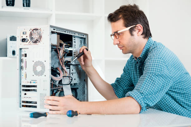 Expert man assembling pc and checking for problem stock photo