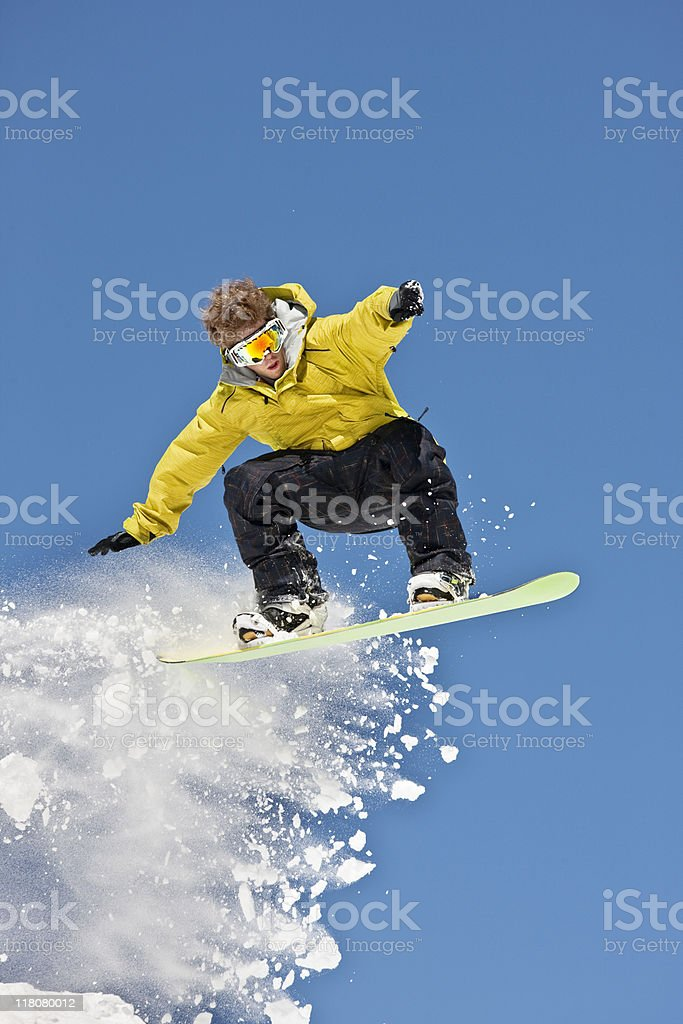 Expert Snowboarder In Jumping Position royalty-free stock photo