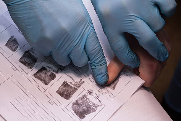 expert takes a fingerprint of the suspect - fingerprint stock photos and pictures