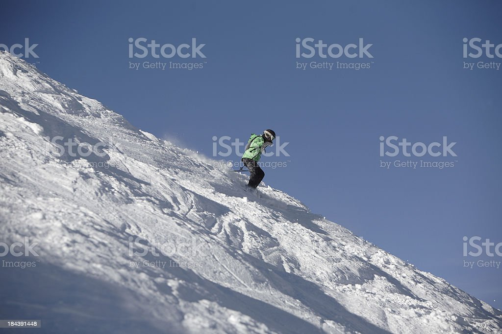 expert woman skier on a steep mogul slope royalty-free stock photo
