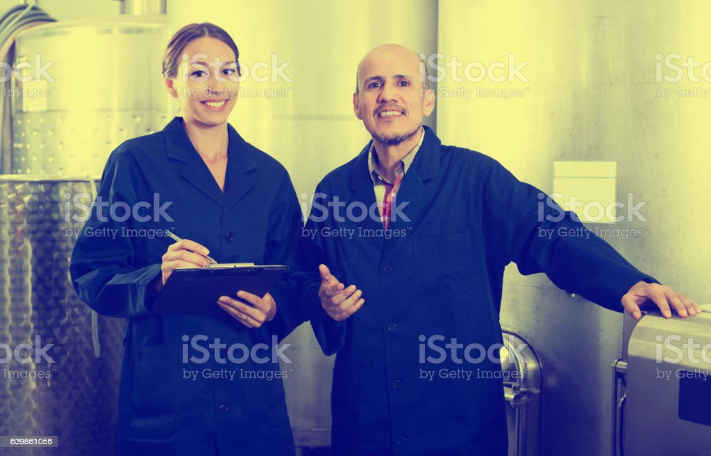Expert woman standing with clipboard stock photo
