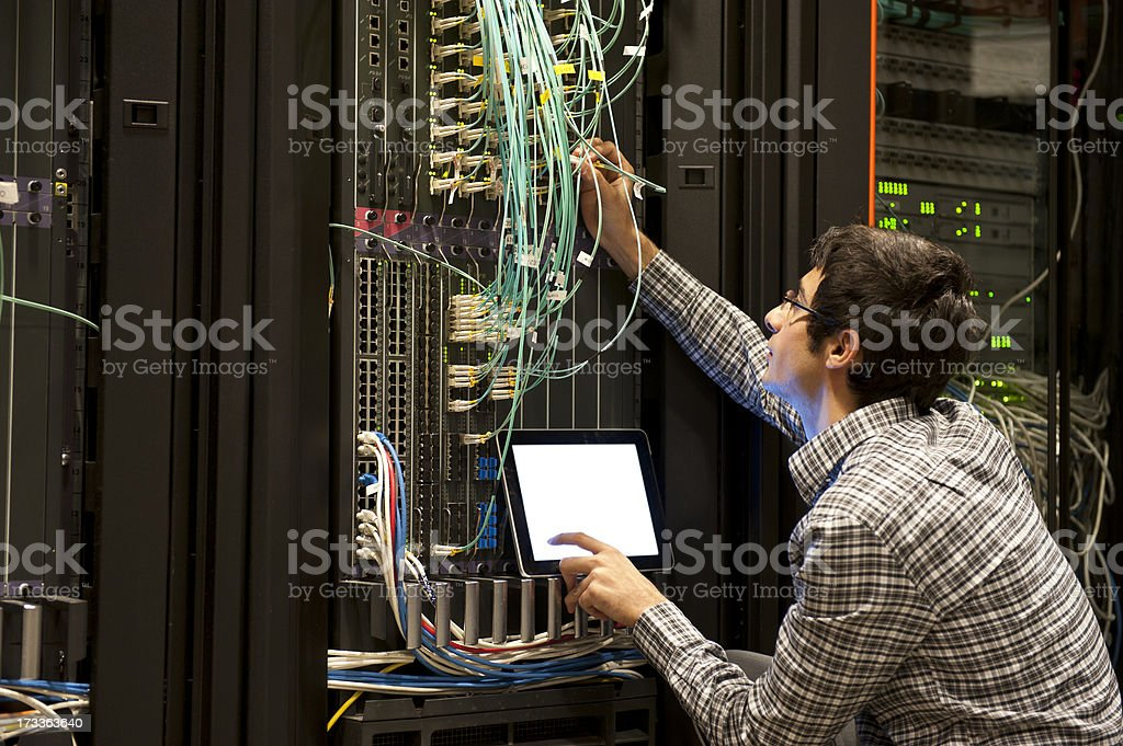 IT expert working on computer server equipment stock photo