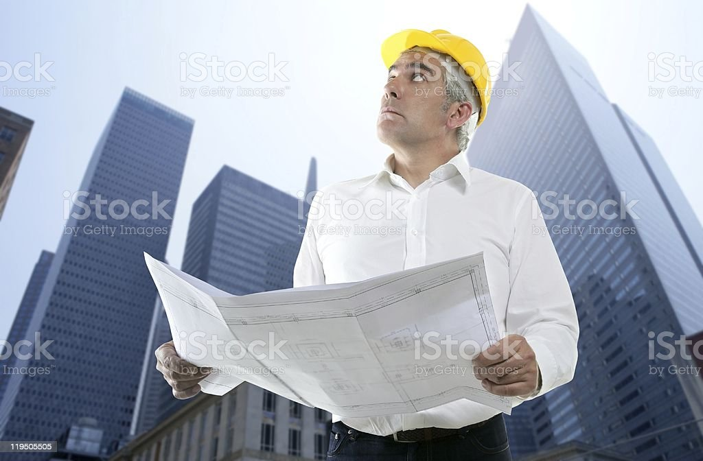 expertise architect engineer plan looking building royalty-free stock photo