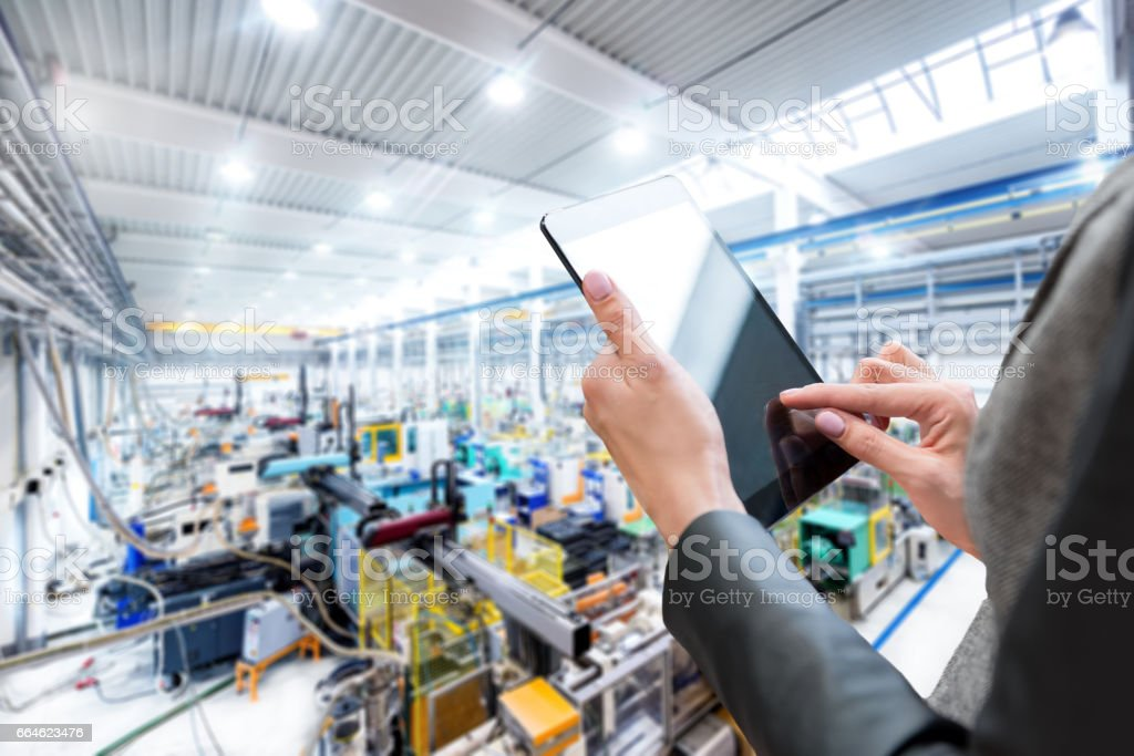 Expertise & digital tablet & production line stock photo