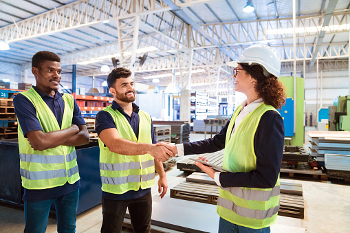 Expertise Shaking Hand With Manager In Factory Stock Photo - Download Image Now