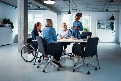 Expertise Sharing Ideas With Colleagues In Office Stock Photo - Download Image Now