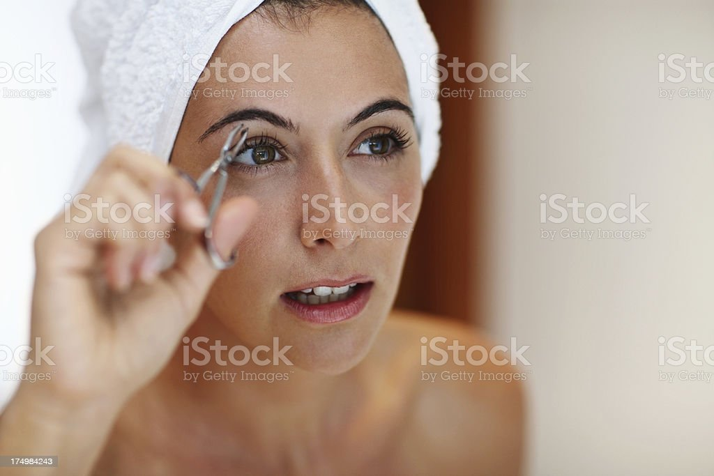 Expertly shaping her eyebrows royalty-free stock photo