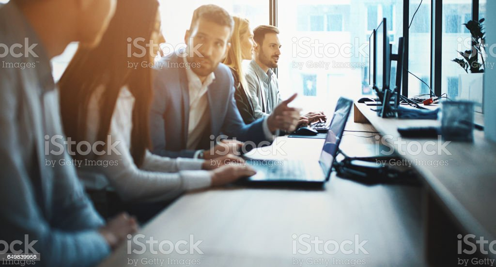 IT experts working on a computer. stock photo