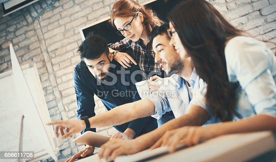 istock IT experts working on a computer. 656611708