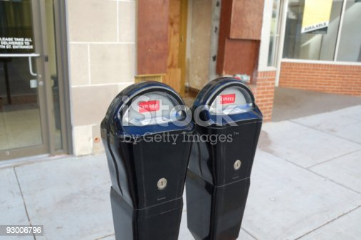 Expired parking meters on a city street