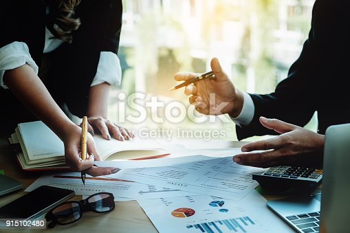 881542122istockphoto CEO Explain analyze the company's sales plan to partnership with use computer laptop, mobile phone, financial document and calculator in 915102480