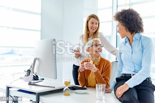 1166905017 istock photo Explaining coworkers new business idea 1157376188