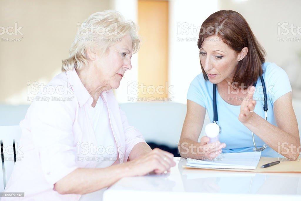 Explaining effectivity of the medication - Senior Healthcare royalty-free stock photo