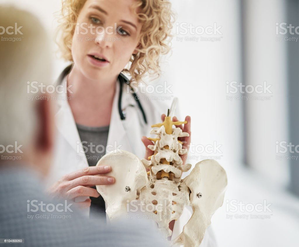 Explaining his condition in detail stock photo