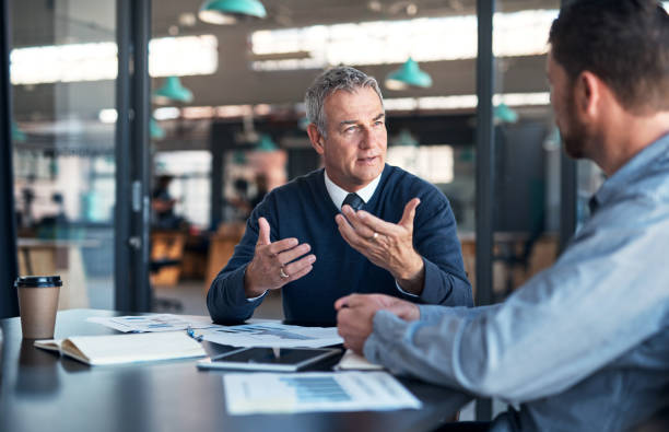 Explaining his vision to a colleague stock photo