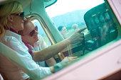 Flight instructor explaining instruments to future pilot.