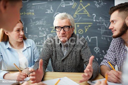 istock Explaining subject to students 905256688