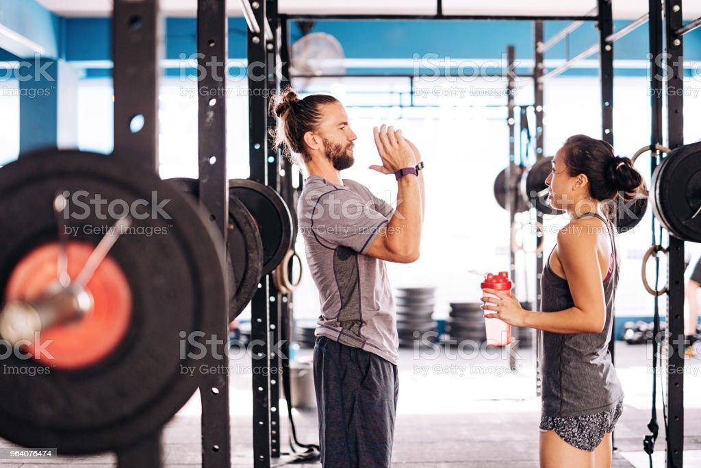 Explaining the essence of the cross and weight training - Royalty-free 20-29 Years Stock Photo