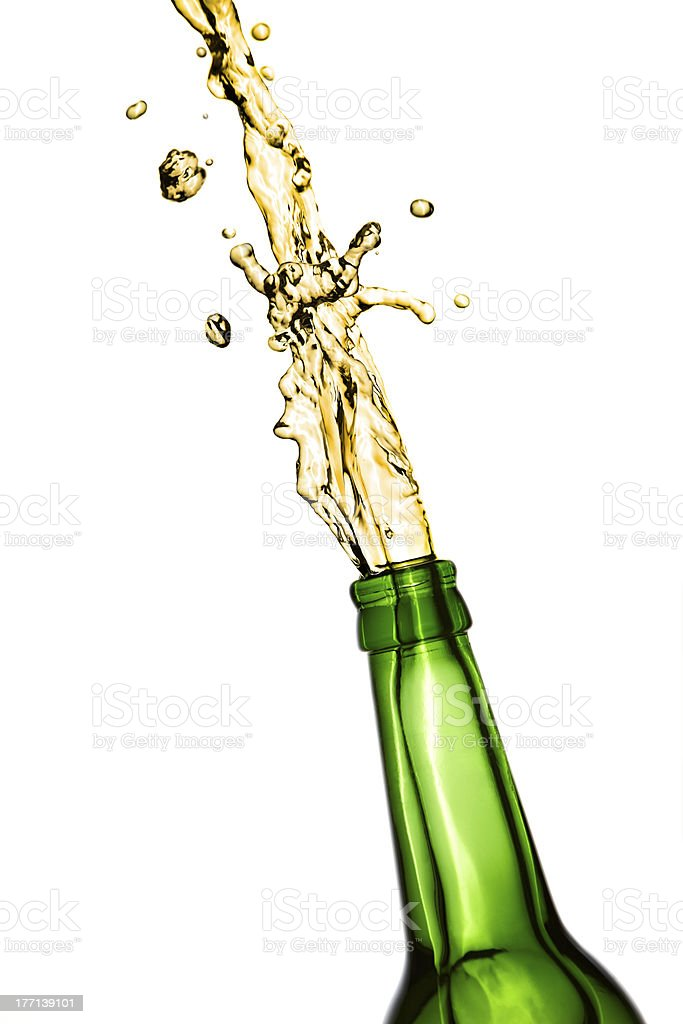 Exploding beer bottle stock photo