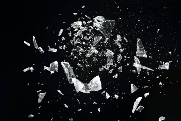 Exploding glass pieces stock photo