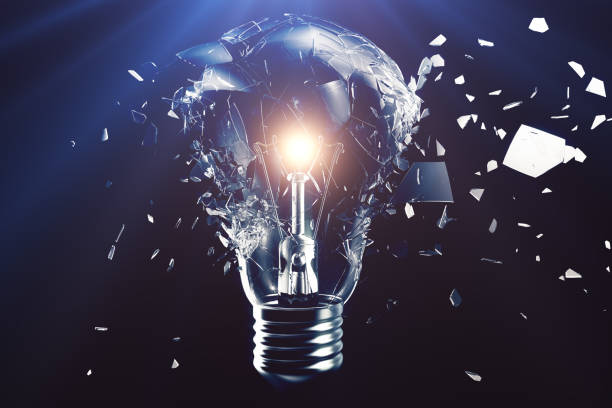 Exploding light bulb on a blue background, with concept creative thinking and innovative solutions. 3D rendering stock photo