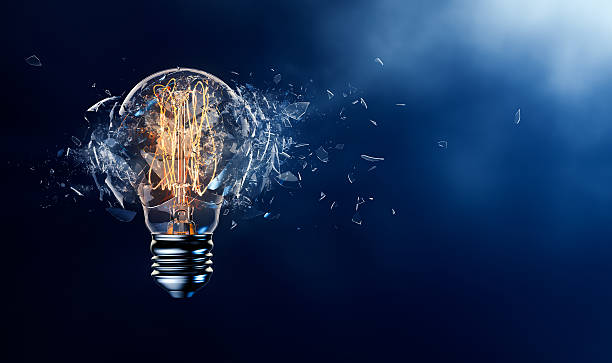 exploding light bulb - innovation stock pictures, royalty-free photos & images