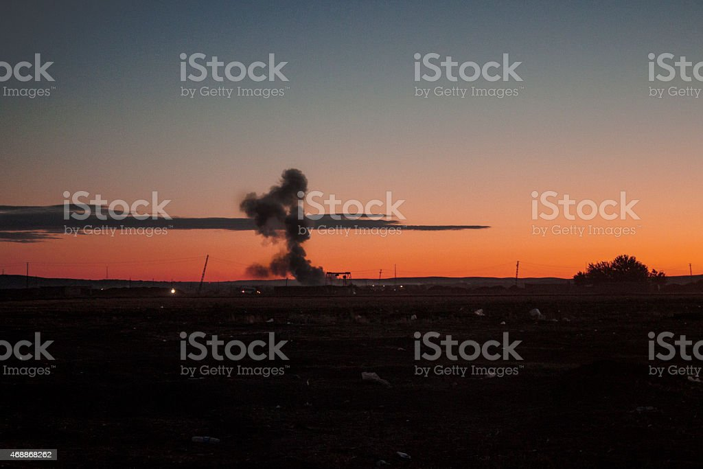 Exploding mushroom bomb at sunset stock photo
