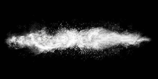 Exploding white powder stock photo