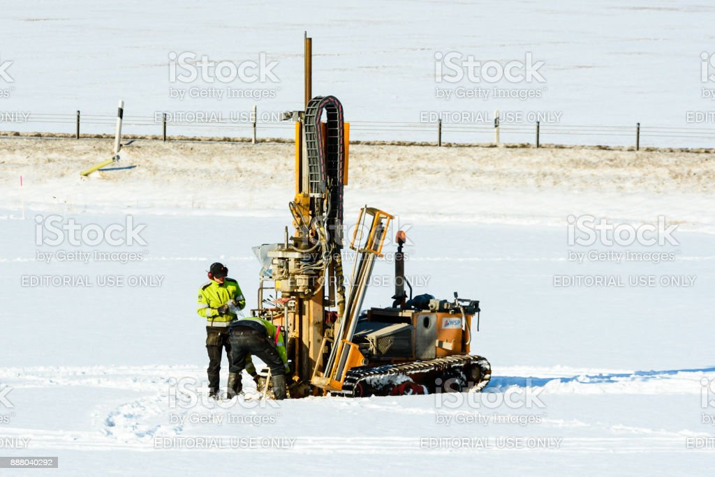 Exploratory drilling on field stock photo