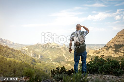 Mature male traveler in the mountains