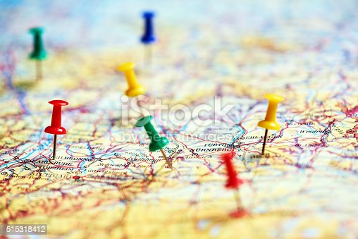 horizontal shot of colorful pins marking different destinations in Europe.