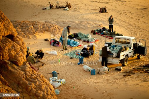 Sahara, Libya - December 27, 2010: Explorers, guides and berbers waking up and preparing for another day in the desert