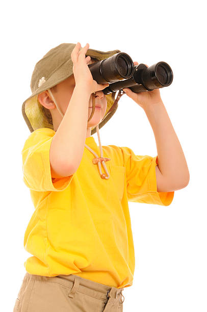 explorer, curious young boy looking up through binoculars - binocular boy bildbanksfoton och bilder