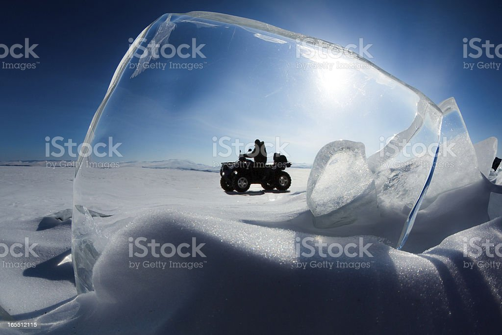 Explorer drives an ATV stock photo