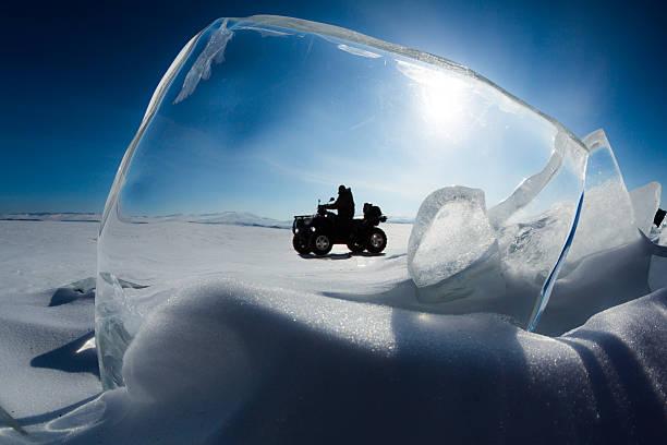 Explorer drives an ATV stock photo