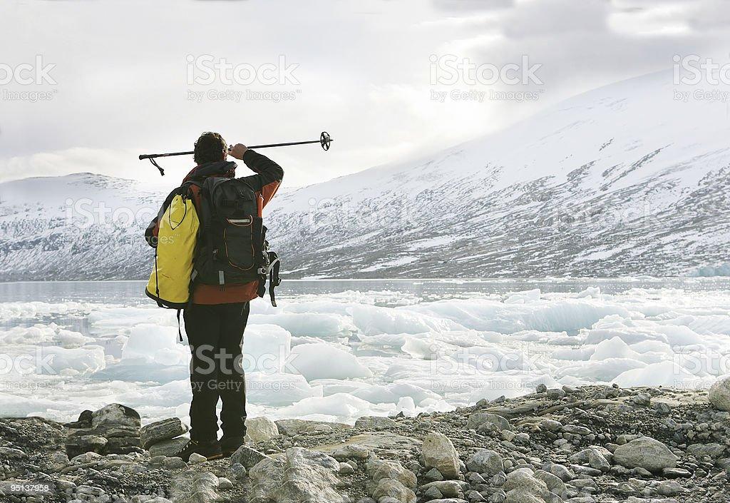 explorer in a glacier stock photo