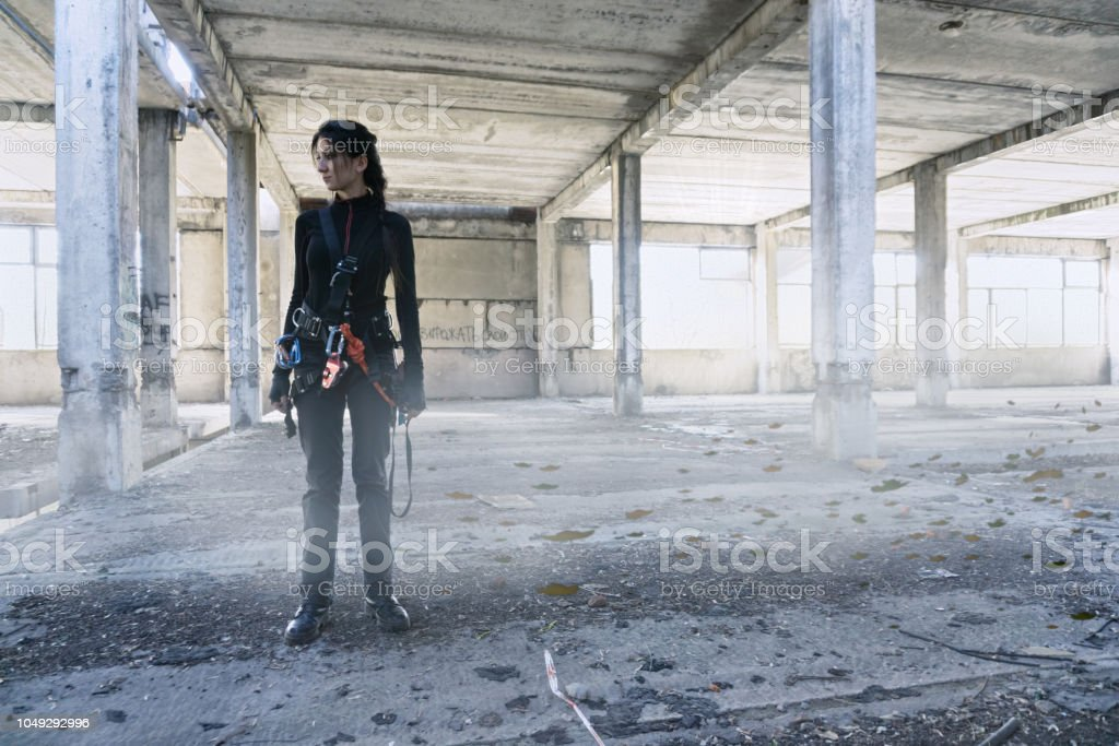 Explorer in abandoned factory stock photo