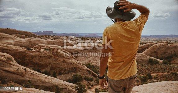 Explorer man hiking near Canyonlands, Moab: South West USA adventures